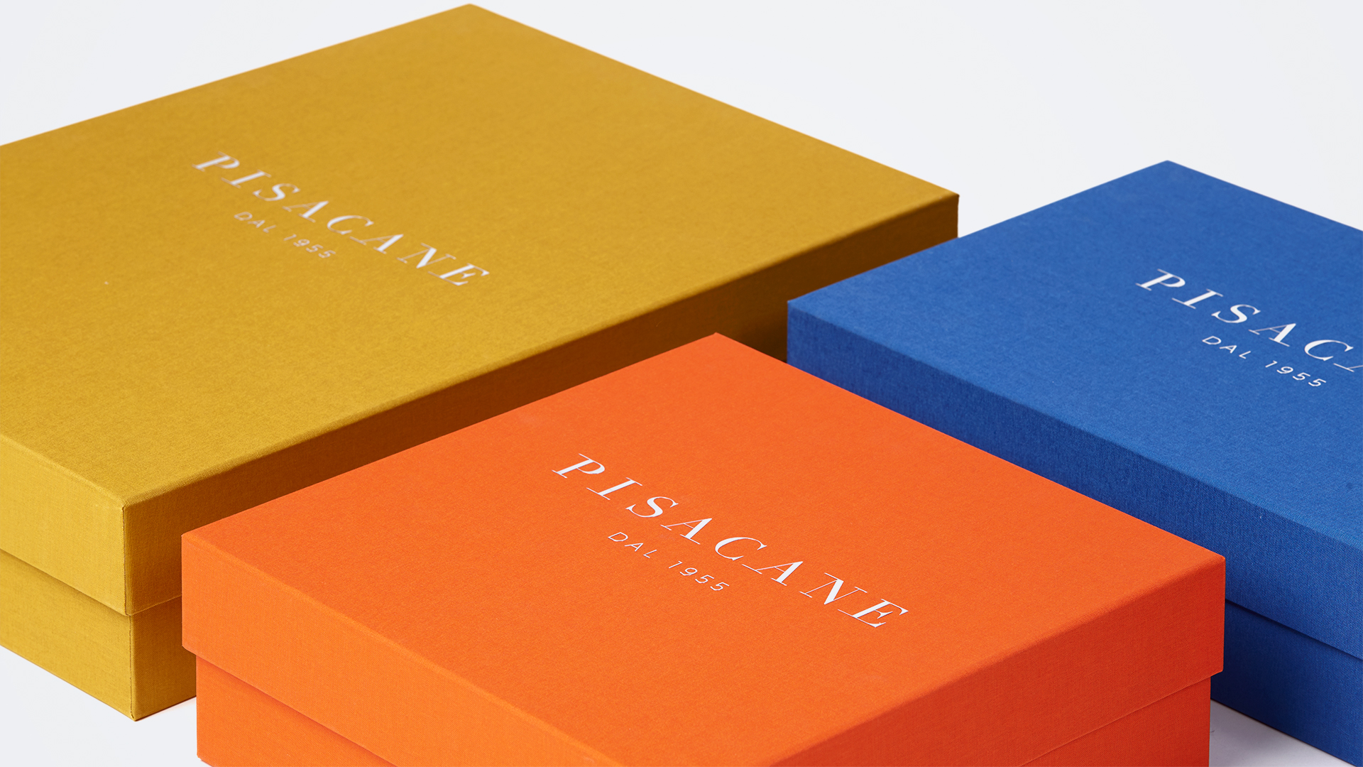 coloured boxes with metallic logo
